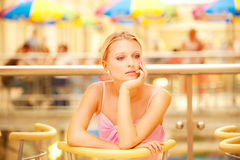 Girl reflects in cafe Stock Image