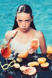 Girl with refresh alcohol in miami. wet girl drink cocktail in swimming pool.  stock images