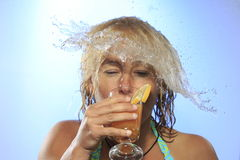 Girl is refreshing. With drink and shower Stock Images