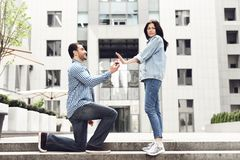 The girl refuses the boy in the marriage proposal. Stock Image