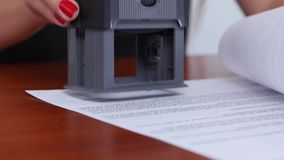 Girl refuses the terms of the contract and puts the appropriate stamp, close up stock video