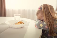 Girl refuses to eat. Child meal difficultes theme. Little girl refuses to eat. Child meal difficultes theme stock photography