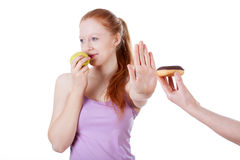 Girl refusing cookie Stock Photography
