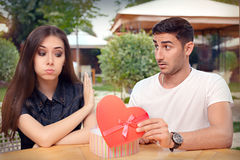 Girl Refusing Heart Shaped Gift From Her Boyfriend Royalty Free Stock Image