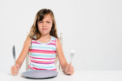 Girl refusing to eat at mealtime Royalty Free Stock Image