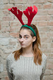 Girl with  reindeer horns Royalty Free Stock Images