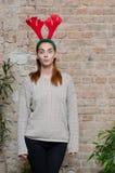 Girl with  reindeer horns Stock Photos