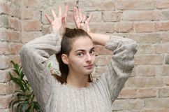 Girl with  reindeer horns Royalty Free Stock Photos