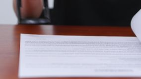 Girl rejects the terms of the contract and puts the stamp. Close up stock footage