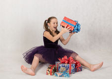 Girl rejoices boxes with gifts Stock Photo