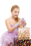 Girl rejoices gifts. White background. Isolate. Stock Image