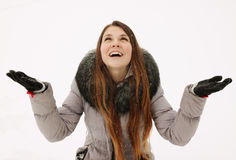 Girl rejoices to snow Stock Photography