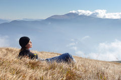 Girl relax. Young woman relaxing on mountain meadow Stock Image