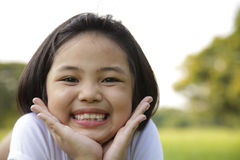Girl Relax And Smiling Happily In The Park Stock Photo