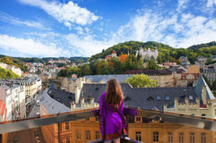 Girl relax on the balcony in the Karlovy Vary. Girl relax on the balcony of Thermal Spa hotel in the sunny autumn day in the Karlovy Vary (Karlsbad stock photography