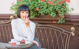 Girl relax cafe with cake dessert. Gourmet concept. Pleasant time and relaxation. Delicious gourmet cake. Woman royalty free stock photo