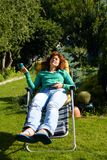 Girl relax in chaise longue on garden Royalty Free Stock Images