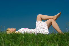 Girl relax on grass meadow Royalty Free Stock Images