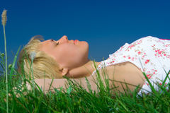 Girl relax on grass meadow Royalty Free Stock Photos