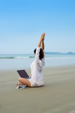 Girl relax with laptop at beach Stock Photography