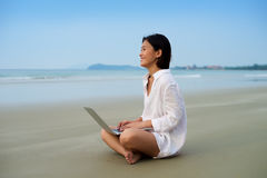 Girl relax with laptop at beach Royalty Free Stock Images