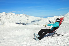 Girl relax in snowy mountains Royalty Free Stock Photos