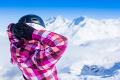 Girl relax in snowy mountains. Royalty Free Stock Photo
