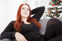 Girl relax on sofa of christmas stress Royalty Free Stock Image