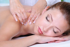 Girl relaxation in the spa salon. Relaxation in the spa salon for the pretty beautiful woman- close-up face Stock Photos
