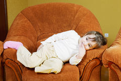 Girl relaxed in chair Royalty Free Stock Images