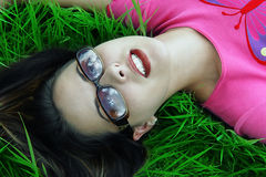 Girl Relaxed Daydreaming. Girl relaxing in the green grass Royalty Free Stock Photo
