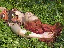 Girl of relaxed lies on the grass Stock Photos