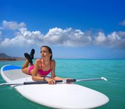 Girl relaxed lying on paddle surf board SUP. Relaxed in summer royalty free stock images