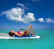 Girl relaxed lying on paddle surf board SUP stock photos