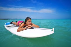 Girl relaxed lying on paddle surf board SUP royalty free stock photos