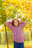 Girl in relaxed pose outside autumn park Stock Photo