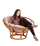 Girl relaxes in a papasan chair isolated on white Stock Photos