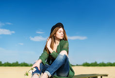 The girl relaxes on the sandy beach at the river. stock photos