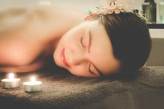 The girl relaxes at the spa salon, aromatherapy, wellness, peeli. Ng and massage