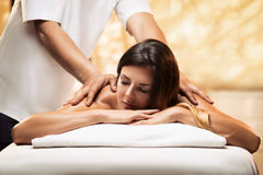 The girl relaxes in a spa salon and gets massage Royalty Free Stock Images