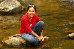 Girl relaxes in stream after hiking Royalty Free Stock Photo