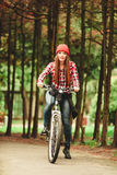 Girl relaxing in autumnal park with bicycle. Stock Photos