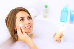 Girl relaxing in bathtub Stock Photo