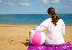Girl relaxing at the beach Stock Image