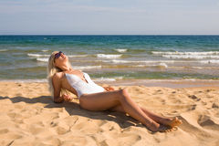 Girl relaxing on beach Royalty Free Stock Images