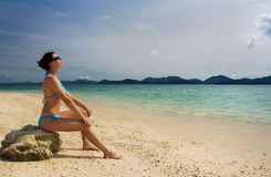 Girl relaxing on beach royalty free stock image