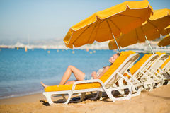 Girl relaxing on a beach chair near the sea Royalty Free Stock Photos