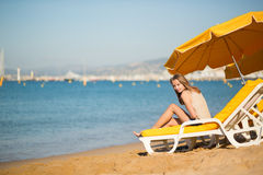 Girl relaxing on a beach chair near the sea Royalty Free Stock Photo