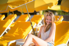 Girl relaxing on a beach chair near the sea Royalty Free Stock Images
