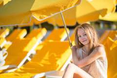 Girl relaxing on a beach chair near the sea Royalty Free Stock Image